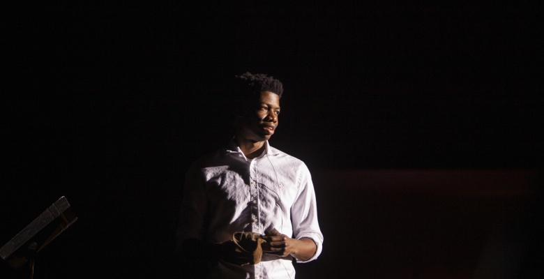 High school student Jabari Chiphe delivers a monologue as Eugene Williams, the teenager whose murder on a Chicago beach sparked the 1919 race riots.