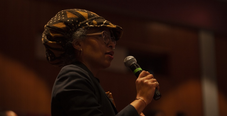 An event attendee participates in the final recap session of the Chicago 1919 opening event at the DuSable Museum.