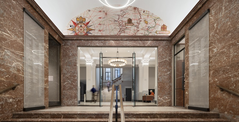 An image from our vast collection of maps greets visitors as they walk through the vestibule and enter the lobby.