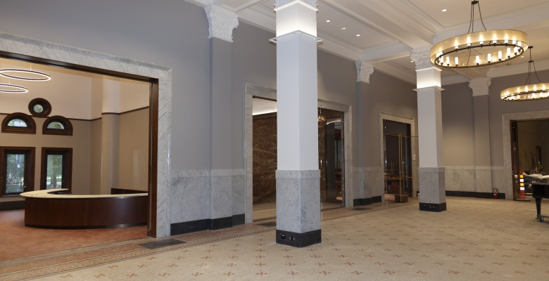 In our lobby, new lighting has been added, our signature mosaic floor has been restored, and original features of the lobby (like marble wainscoting) have been reintroduced.