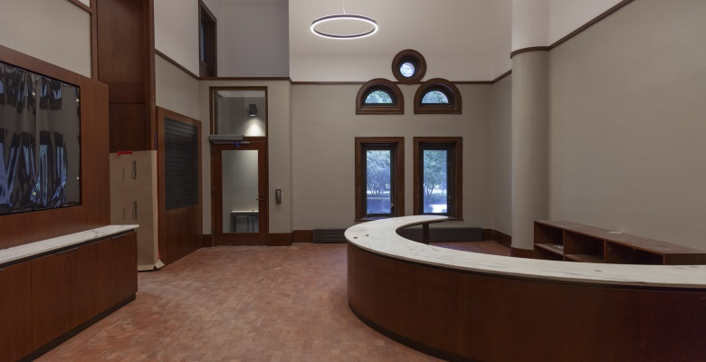 Our new welcome center will feature a information desk where visitors can consult with librarians, sign up as readers, and learn about the Newberry. Other features include digital screens (left) and an ADA lift for entering and exiting the library.