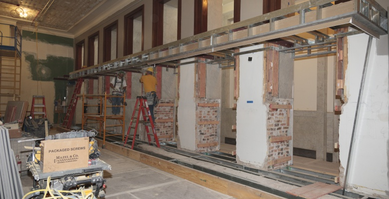 Building the canopy and base of the 46-foot-long display case in the Hanson Gallery