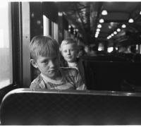 Esther Bubley. Young commuter bound for school on suburban train.