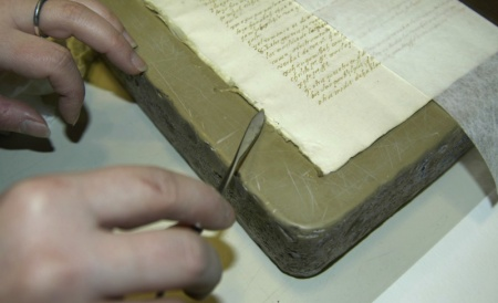 A Newberry conservator works on a manuscript copy of the Popol Vuh.