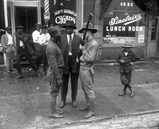 During Chicago's 1919 Race Riots, African American veterans defended their communities from attacks by whites, while the state militia eventually quelled violence. Chicago Tribune Archives/TNS.