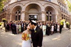 Sharing a kiss in front of the main entrance.  Kevin Weinstein Photography.