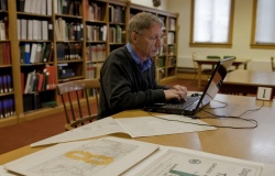 A reader studies CB&Q materials in Special Collections.